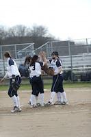 TEAMWORK IS DREAMWORK: Brandeis softball players celebrate a win against Emory University on April 14.