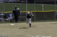 CROSS CORNERS: Third Baseman P.J. Ross throws to first to try to beat the runner during a game against NYU on April 16, 2017.