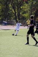CRUSHED KICK: Midfielder Joshua Handler '19 looks to boot the ball down the field during Homecoming this past Saturday.