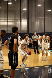 AT THE LINE: Forward Chandler Jones '21 collects himself for a free throw against Becker College this past Saturday.