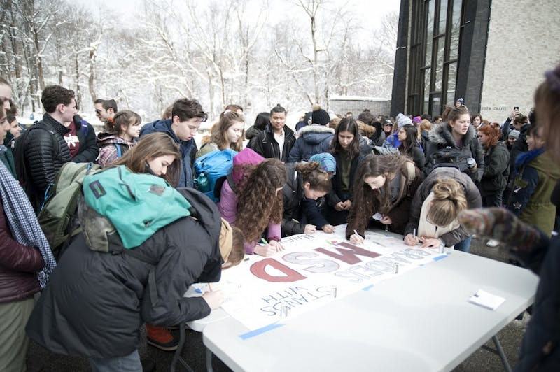 REMEMBRANCE: Students gathered at Chapels Pond to remember the victims of the Parkland high school shooting on Wednesday.