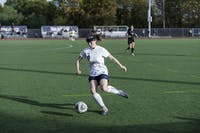 GAINING GROUND: Defender Emily Thiem '19 works her way downfield during a match against New York University on Nov. 4.