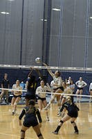HOMECOMING STUD: Middle hitter Belle Scott '21 crushes the ball over the net during Homecoming this past Saturday.