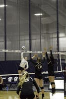 SUPER SPIKE: Outside hitter Clare Meyers '21 sets up to crush the ball over the net against Bowdoin College on Sept. 8.