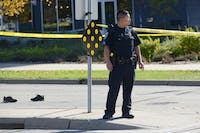 UMPD Sergeant Long Xiong observes the scene of a collision that occurred between a pedestrian and a semi truck at the Stadium Village light rail station on Wednesday, Oct. 18.