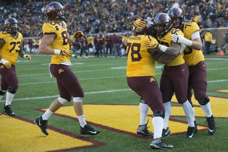 The Gophers celebrate a touchdown at TCF Bank Stadium on Saturday, Nov. 11.