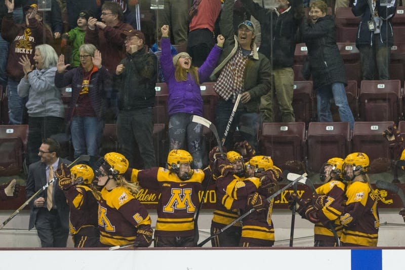 The Gophers celebrate their empty-net goal late in the third period to seal their victory in the WCHA championship game against Wisconsin at Ridder Arena on Sunday, March 4.