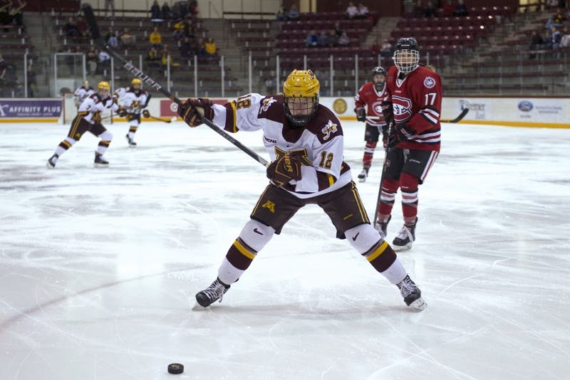 Forward Grace Zumwinkle readies to hit the puck during the first round of the WCHA Playoffs against St. Cloud State on Friday.