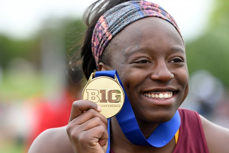 Temi Ogunrinde holds up a medal during the Big Ten Championship on May 12, 2017.