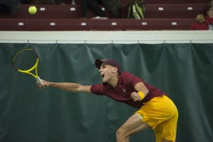 Freshman Jackson Allen returns the ball during his singles match at the Baseline Tennis Center on Friday, Feb. 2.
