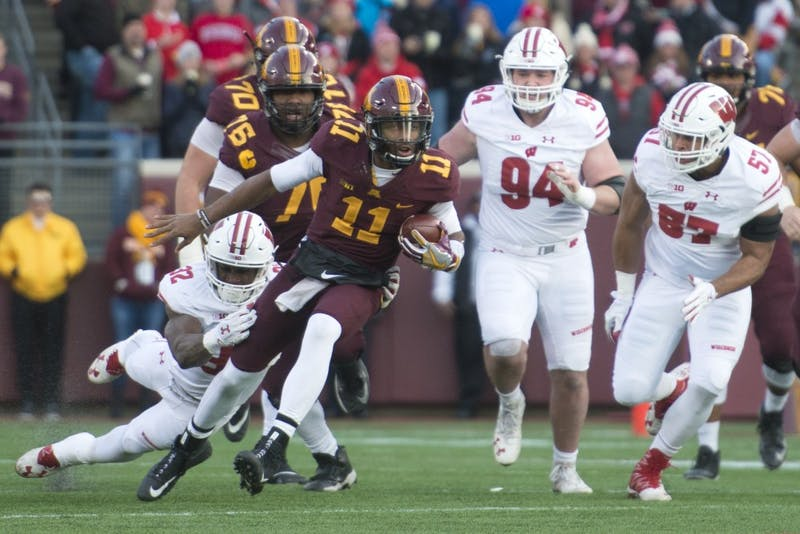 Gophers quarterback Demry Croft rushes with the ball at TCF Bank Stadium on Saturday, Nov. 25. The Badgers defeated the Gophers 31-0.