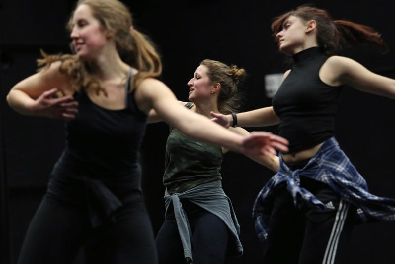 Katie Kummerow, center, runs through a class-choreographed combination on Thursday, Feb. 22 at Barbara Baker Dance Center on West Bank. The modern dance class learned by dancing from their teacher and with each other, a format typical to the University dance program.