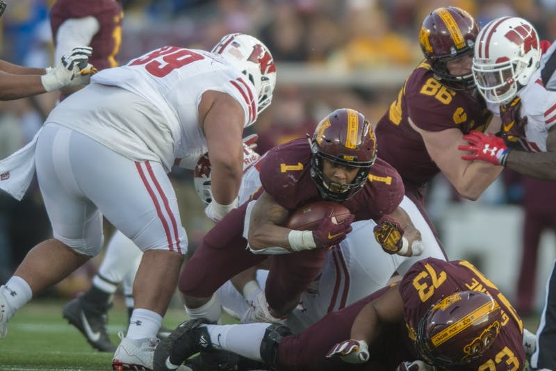 Minnesota running back Rodney Smith dives from a tackle during the game against Wisconsin on Saturday, Nov. 25 at TCF Bank Stadium. The Badgers beat the Gophers 31-0.