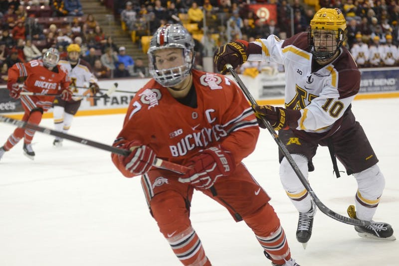 Forward Brent Gates Jr. chases after the puck during a game against Ohio State on Friday, Dec. 2, 2016 at 3M Arena at Mariucci Arena.