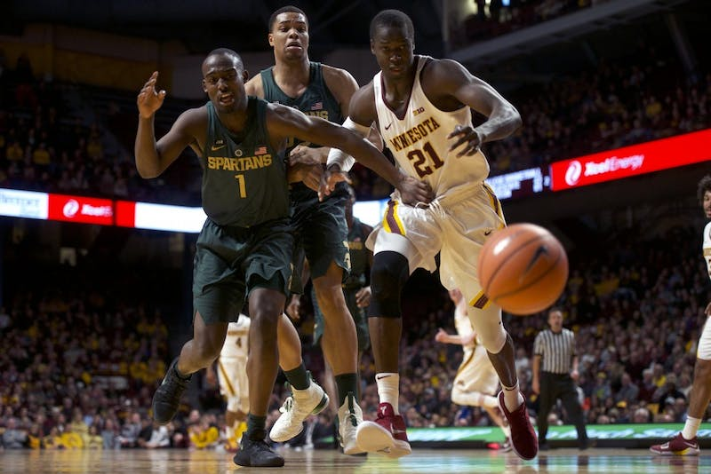 Senior center Bakary Konaté runs after the ball during a game against Michigan State at Williams Arena on Tuesday, Feb. 13.