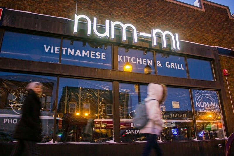 Pedestrians pass by Num-Mi in Dinkytown Tuesday, Dec. 5. The owners hope to open early next year.