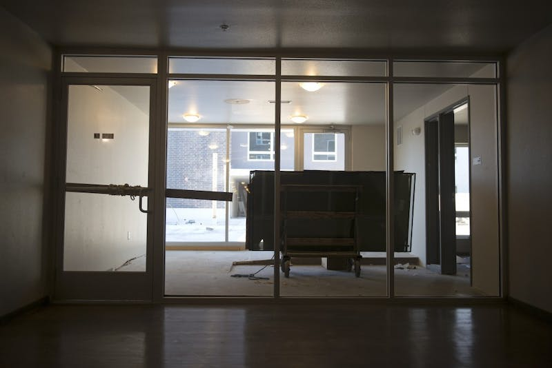 A wooden plank tied to the door serves as a locking mechanism to prevent people from entering an unfinished rooftop terrace on Monday, Oct. 16, at the unfinished Prime Place Apartments in Prospect Park.