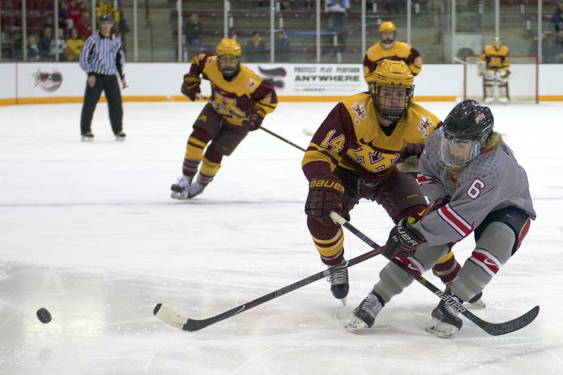 Forward Lindsay Agnew fights for the puck during a game against Ohio State for the WCHA Final Faceoff semifinal on March 3 at Ridder Arena.