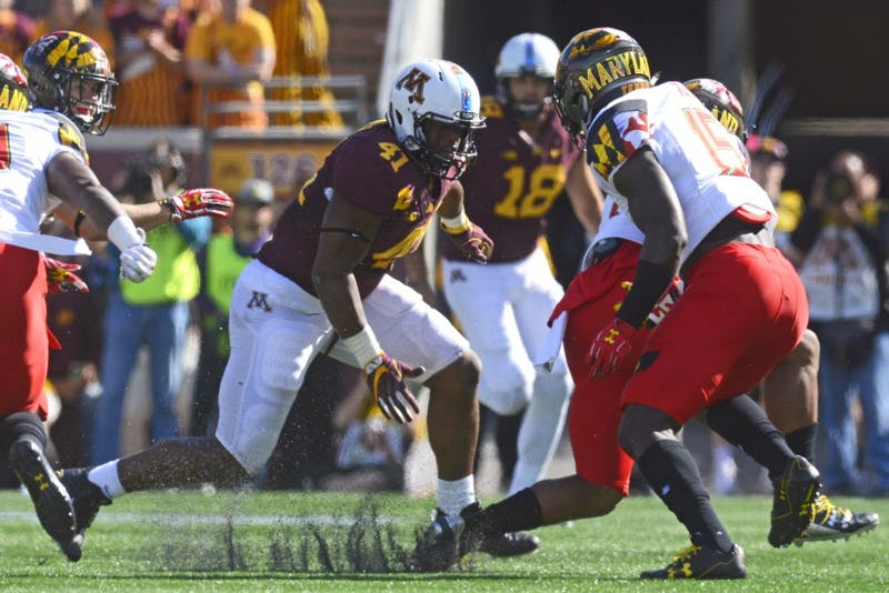 Linebacker Thomas Barber runs to intercept the ball carrier on Sept. 30 at TCF Bank Stadium.