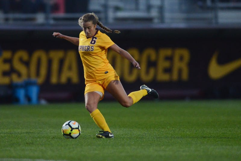Midfielder Molly Fiedler kicks the ball during the Gophers' match against Utah State at Elizabeth Lyle Robbie Stadium on Sept. 8.