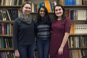 From left, Art Words judges Hannah Nelson, Tripura Talagadadeevi, and Laurel Darling pose for a portrait in Lind Hall on Tuesday.