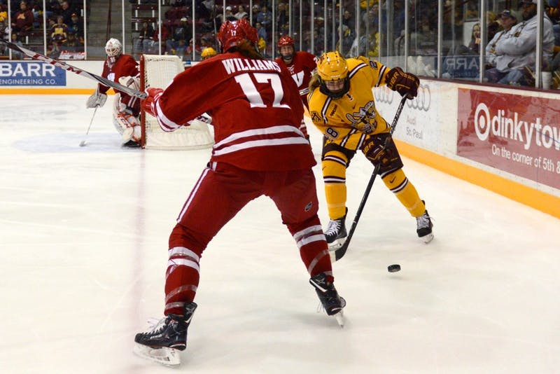 Freshman forward Taylor Wente maneuvers behind the goal line at Ridder Arena on Oct. 29.