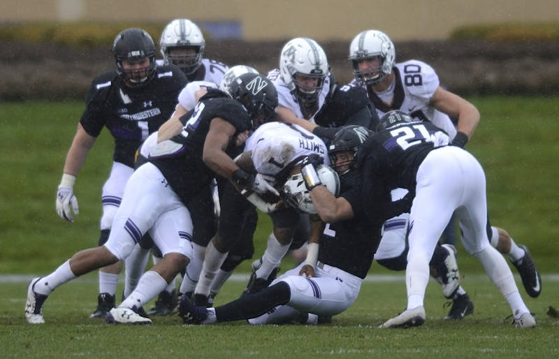 Rodney Smith gets tackled by Northwestern players on Saturday, Nov. 18 at Ryan Field in Evanston, Illinois.