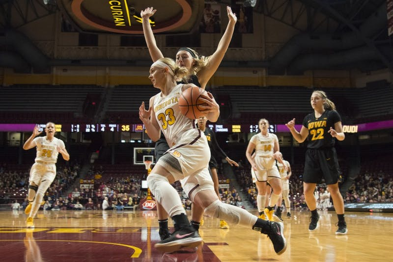 Senior guard Carlie Wagner runs the ball during a game against Iowa at Williams Arena on Jan. 21, 2018.