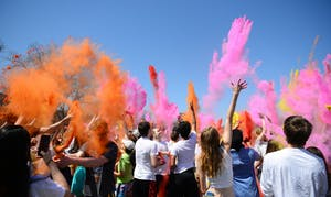 Color is thrown into the air at the Holi Festival at East River Flats Park on Sunday, April 29.