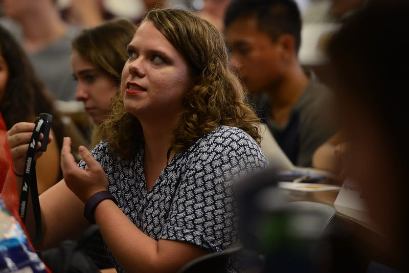 Brianna Hanson, a ranking representative of the student senate, addresses At-Large Rep candidates at the first Minnesota Student Association forum of the semester on Sept. 12 in Frasier Hall on East Bank.