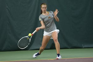 Sophomore Cammy Frei returns the ball during her singles match against the University of South Dakota at the Baseline Tennis Center on Friday, Feb. 9.