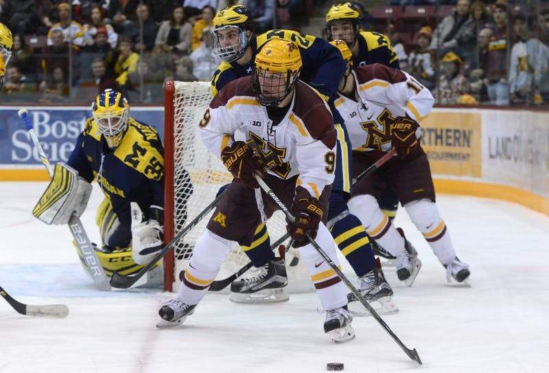 Gophers forward Mike Szmatula looks for a passing outlet against Michigan on Friday, Jan. 13, 2017 at Mariucci Arena.