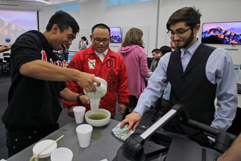 Secretary of the Pi Delta Psi Fraternity, Yengcha Lee, teaches Social Chair of the Pi Delta Psi Fraternity, Zachary Keo, how to make tea at Bruininks Hall on Friday, Oct. 6. This was a tea ceremony event between the Pi Delta Psi Fraternity and the Japanese Student Association.