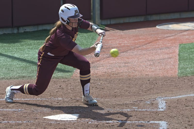 Senior Dani Wagner bunts at bat at the Jane Sage Cowles Stadium on Saturday, April 21.