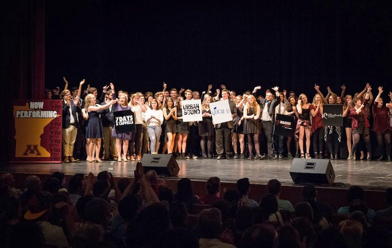 University of Minnesota a cappella groups stand on stage as the winner of Battle for the Vox is announced.