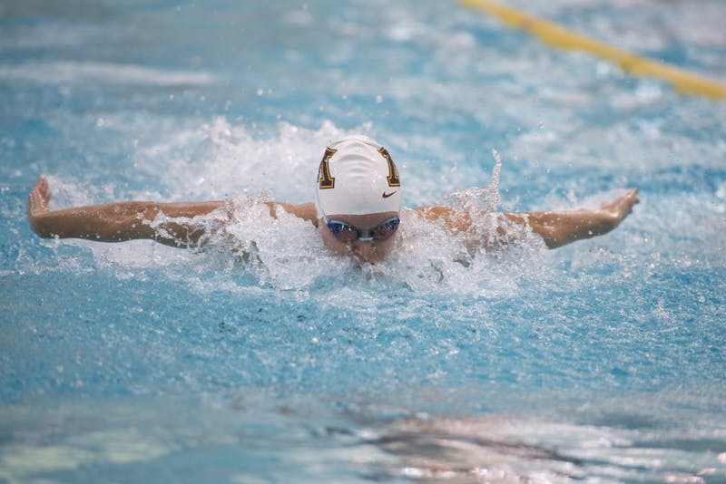 Senior Danielle Nack competes in the women's 100 yard butterfly at the Jean K. Freeman Aquatics Center on Saturday, Jan. 27.