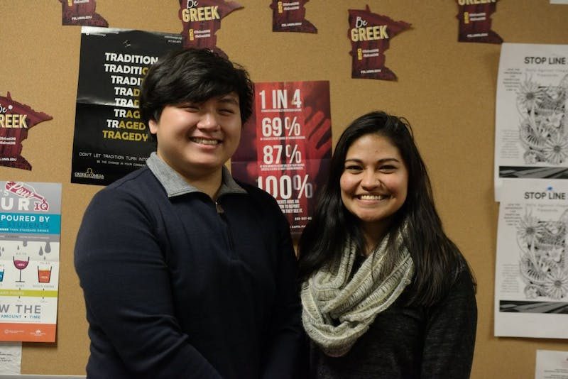 Newly-elected president of the Multicultural Greek Council Kevin Dinh, left, and Vice President Rosa Ruiz Mendez pose for a photo in Appleby Hall on Tuesday, Dec. 5.