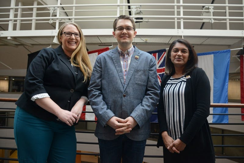 Elisha Friesema, Stephen Palmquist and Prachi Bawaskar pose for a portrait in Carlson School of Management on Tuesday, May 1.