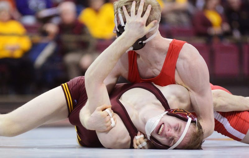 Sophomore Ethan Lizak takes on Nebraska's Tim Lambeth at the Sports Pavilion on Friday, Jan. 20.