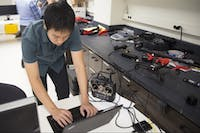 Grad student Tien Do inputs data into a computer to demonstrate a drone flying in the MARS lab on Friday, Sept. 29.