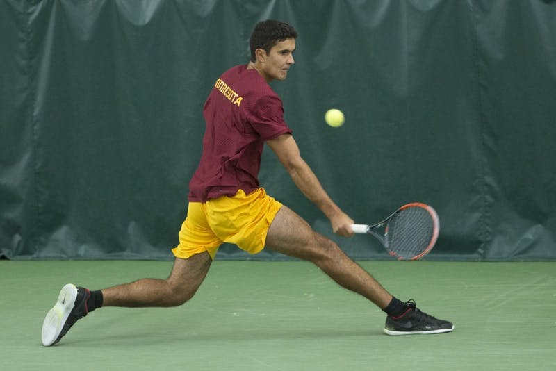 Junior Josip Krstanovic returns the ball during his singles match at the Baseline Tennis Center on Friday, Feb. 2.