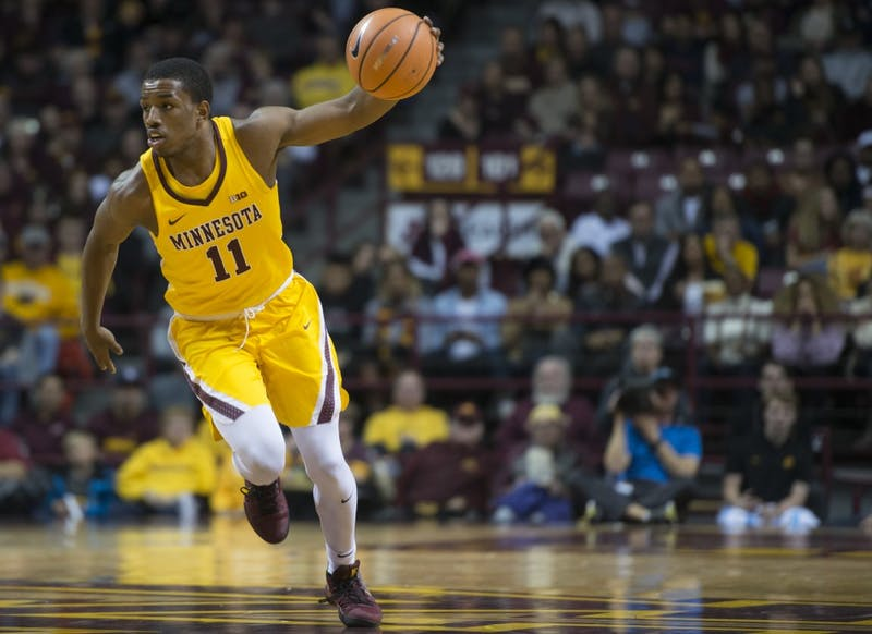 Guard Isaiah Washington looks to drive towards the hoop at Williams Arena on Sunday, Nov. 19.