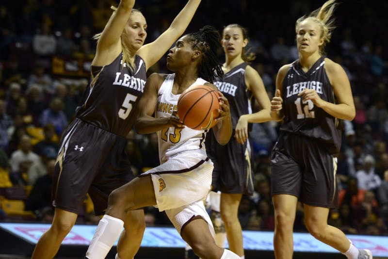 Guard Kenisha Bell prepares to throw the ball in the game against Lehigh University at Williams Arena on Saturday, Nov. 11.