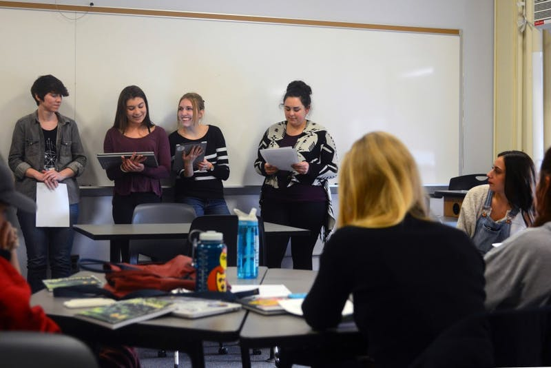 Editors and other staff members of The Tower meet and prepare for this year's magazine launch in Lind Hall on Tuesday, April 17. The Tower's 2018 art and literary magazine launches on Thursday night at the Wiseman Art Museum.