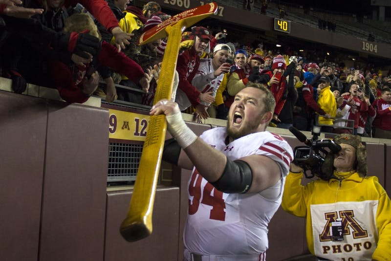 Badgers defensive end Matt Henningsen celebrates the victory with fans at TCF Bank Stadium on Saturday, Nov. 25. The Badgers defeated the Gophers 31-0.