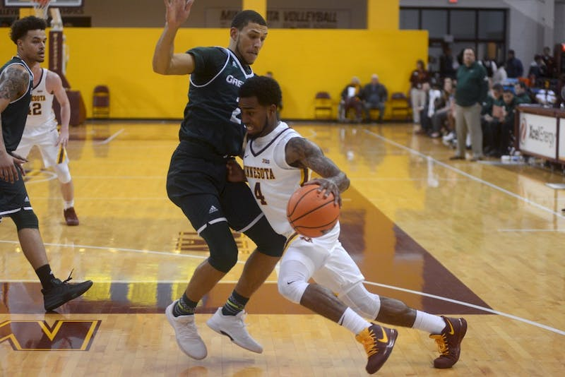 Freshman guard Jamir Harris pushes through Green Bay defense at Maturri Pavilion on Sunday, Nov. 5.