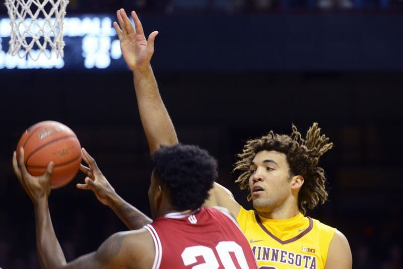 Gophers center Reggie Lynch reaches to block a shot during a game against Indiana on Feb. 15, 2017. Lynch was expelled after allegations of sexual misconduct.