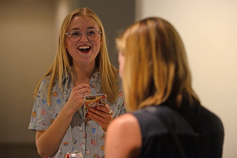 Ellie Peterson, social media editor at the Riveter laughs while talking to groups of Lit Crawl attendees