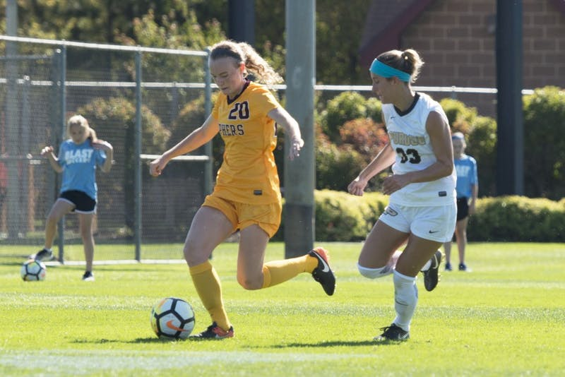 Forward April Bockin carries the ball during the Gophers' game against Purdue at Elizabeth Lyle Robbie Stadium on Oct. 8.