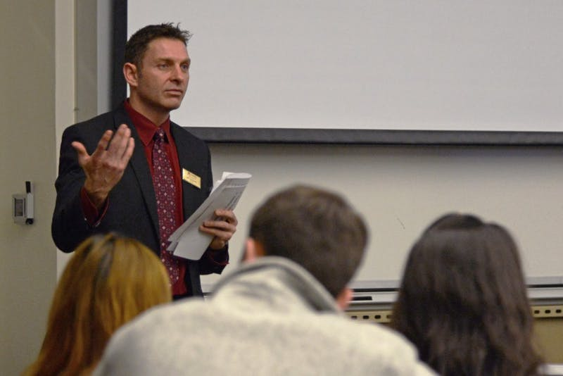 Jeff McKinley, resident district manager for the University's food supplier Aramark, fields questions from MSA representatives about the University's dining contract during forum in Frasier 102 on Tuesday.